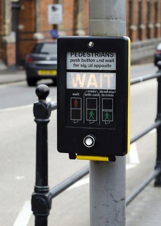 deatil: Deatil of  a  button on pedestrian crossing.