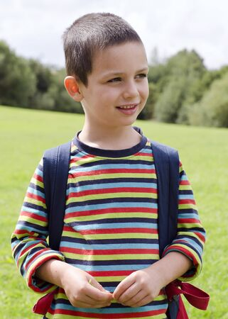 child portrait: Portrait of a child boy standing on a meadow on a nature walk. Stock Photo