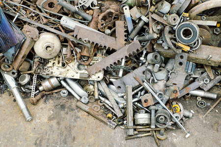 Pile of scrap metal pieces on a pile, recycling concept.