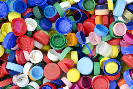 Plastic bottle caps or tops backgound, recycling concept.