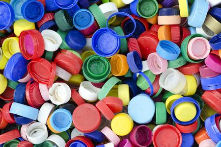 kunststoff: Plastikflaschenkapseln oder Tops backgound, Recycling-Konzept. Lizenzfreie Bilder