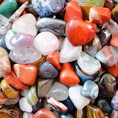 Colorful semi precious quartz stones, top view, background image