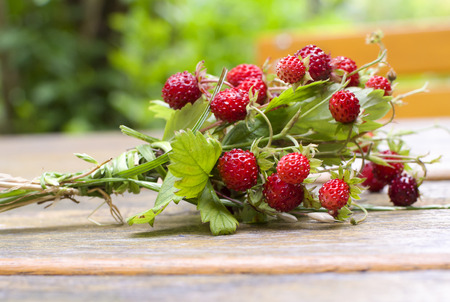 Wild strawberry bouquet on garden table