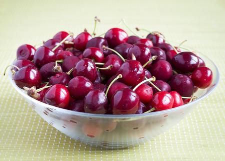 Bowl of red fresh cherries fruit