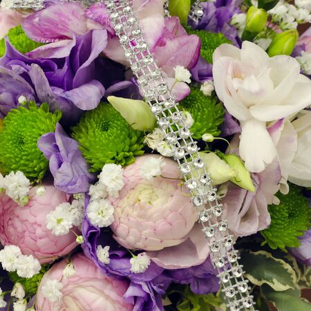 Wedding flower bouquet detail decorated with jewelery