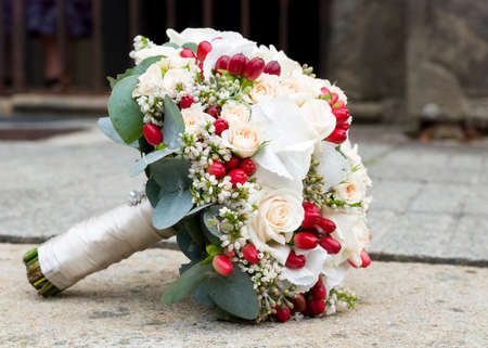 whithe: Wedding bouqet of roses and flowers on a ground