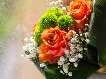 Detail of flower bouquet with orange roses Stock Photo