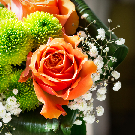 Detail of flower bouquet with orange rose Stock Photo