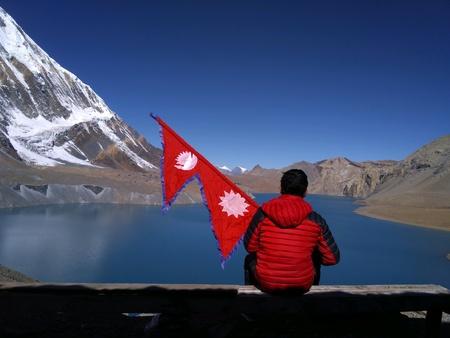 Tilicho Lake with national flag