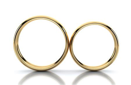 Par de anillo de oro aislado sobre fondo blanco