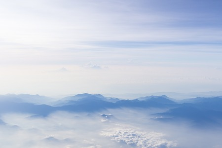 Blue sky and mountains view from airplane stylized hipster background with copyspace. Stock Photo
