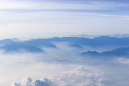 copysapce: Blue sky and mountains view from airplane stylized hipster background with copyspace. Stock Photo