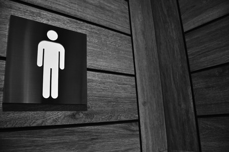 restroom sign look like he waiting for someone who fill his loneliness.