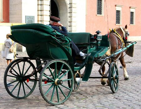 hackney carriage: Carriage with a sleeping coachman in Warsaw Old Town. Stock Photo