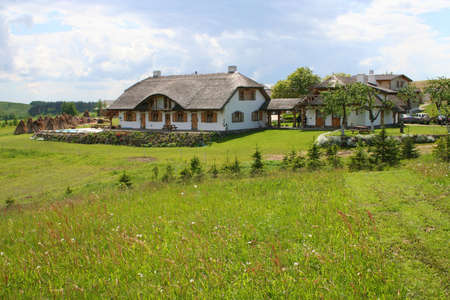 Modern house built in a traditional style. Beautiful rural landscape. Stock Photo - 2045293