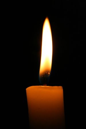 Warm light of a candle in a dark place Stock Photo - 2119668