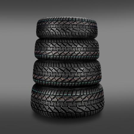Pile of car tires isolated on dark background