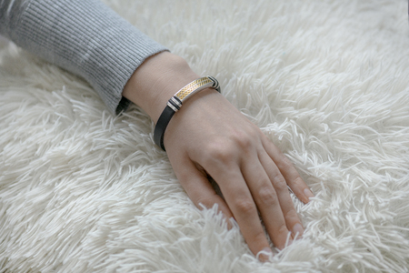 Bracelet on woman hand close up. Horizontal image 스톡 콘텐츠