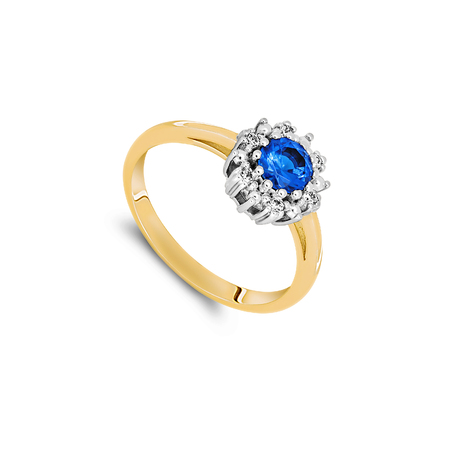 Gold ring with blue sapphire isolated on white background
