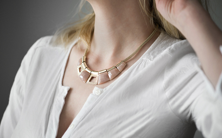 Gold necklace on womans neck