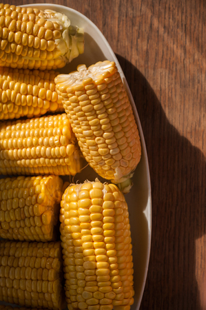 Corn cobs on the plate close up Stock Photo