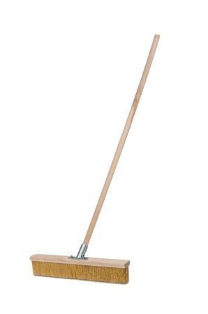 Broom with long wooden handle isolated on white background. Cleaning equipment for housework