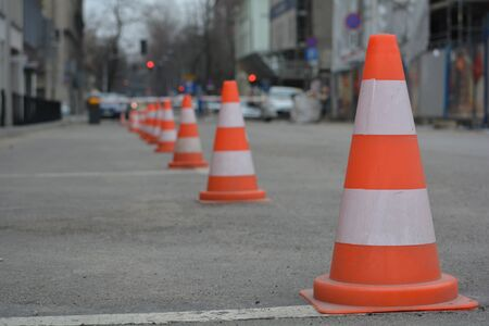 Parking lane separated by white and orange traffic cones