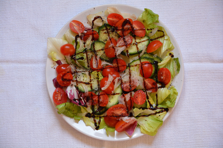 Morning plate of salad on a white table cloth