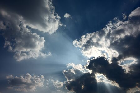 There is hope. Blue sky with some cumuli obscuring the sun; dark clouds with silver lining