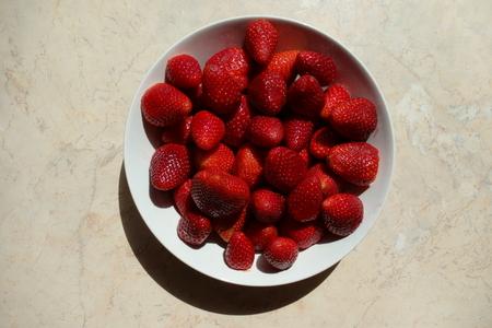 Bowl of fresh strawberries, top view