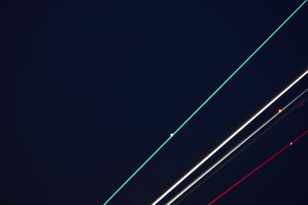 Jetliner taking off into darkening skies, light streaks, abstract Zdjęcie Seryjne