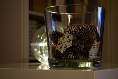 Season decorations in a glass bowl