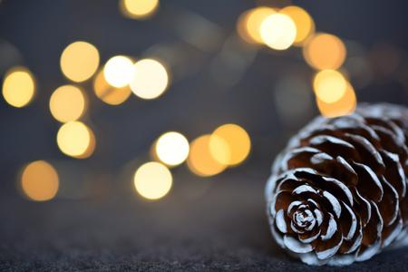Spruce cone against blurred Christmas lights Zdjęcie Seryjne