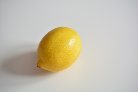 Fresh lemon on a smooth white surface Zdjęcie Seryjne