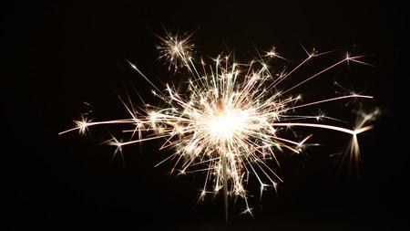 Sparkler burning against a hollow black background
