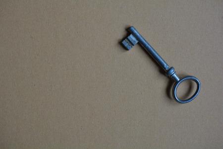 Vintage key on a cardboard screen