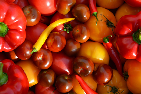 Assorted tomatoes, red bell peppers and chili peppers