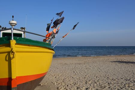 Yellow fishing boat on the beach