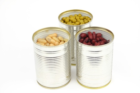 The tins with peas, bean, red bean on the white background photo