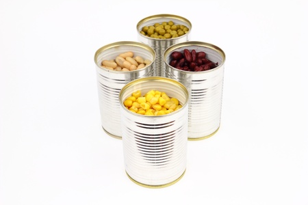 The tins with peas, bean, red bean, corn on the white background photo