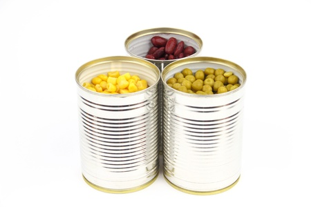 The tins with peas, red bean, corn on the white background photo