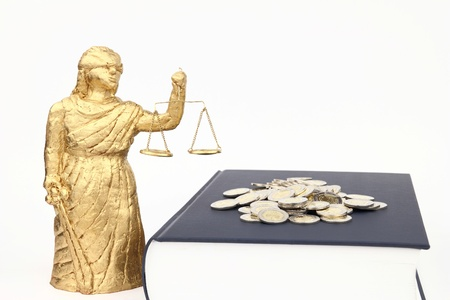 Themis, book and money on the white background photo