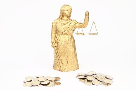 Themis and money on the white background photo