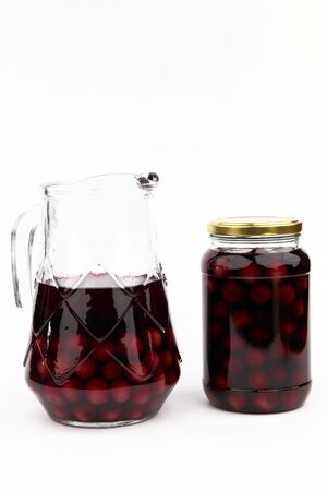 ewer: Compote with cherries in jar and ewer Stock Photo