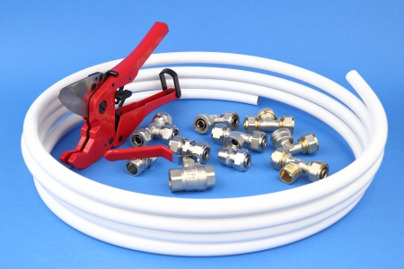 mountings: The pex pipe and armature on the blue background