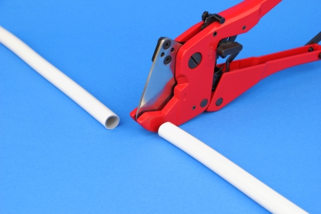 mountings: The cutting pex pipe on the blue background