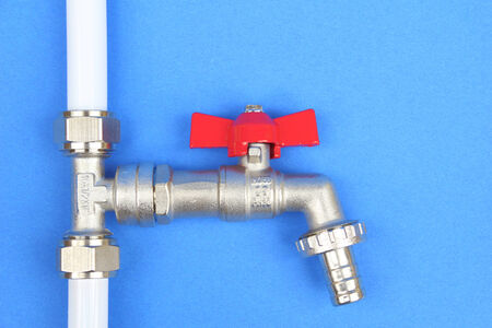 mountings: The part of water installation on the blue background