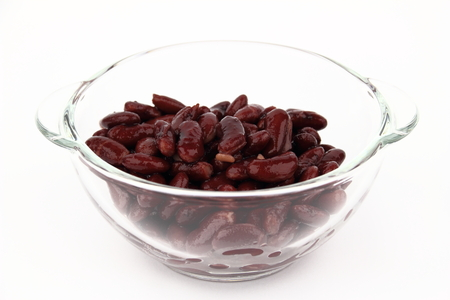 potherb: The bean in glass dish on the white background