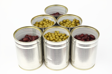 tinned: The tins with peas and red bean on the white background Stock Photo