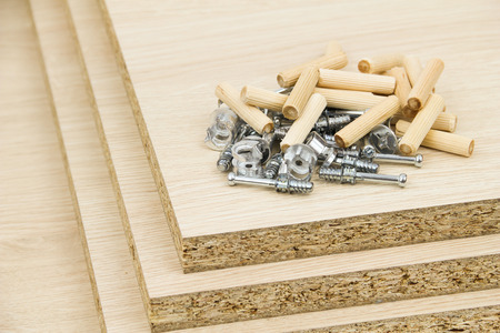 Chipboard and furniture accessories